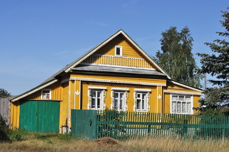 Beautiful wooden yellow country house with carved front, Russia