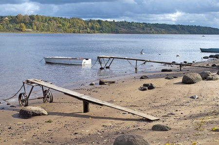 Bank of the Volga with old boats in the autumn Stock Photo - 12246235