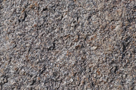 Natural rough brown stone surface texture photo