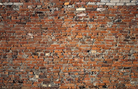Closeup of weathered red brick wall background photo