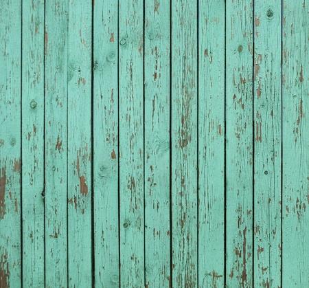 Gros plan de vieux panneaux de clôture en bois vert Banque d'images