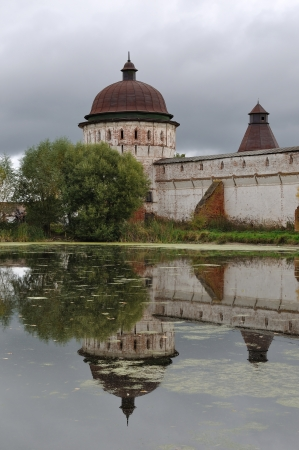 Tower of ancient russian Monastery of Sts Boris and Gleb near Rostov the Great, reflected in a pond photo