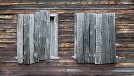 Two boarded windows in wooden summer house