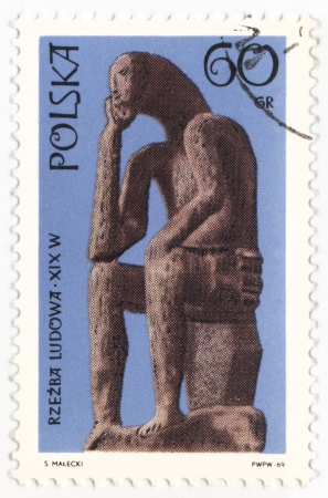 POLAND - CIRCA 1969  a stamp printed in Poland, shows statue of seated man, series  Folk sculpture , circa 1969