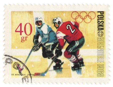 POLAND - CIRCA 1968  A post stamp printed in Poland shows ice hockey, devoted to the Olympic Winter Games in Grenoble, series, circa 1968 Stock Photo - 16768166