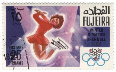 fujeira: Fujeira - CIRCA 1968  A stamp printed in Fujeira shows women