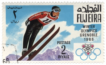 Fujeira - CIRCA 1968  A stamp printed in Fujeira shows ski jumper, devoted to the Winter Games in Grenoble, series, circa 1968 Editorial