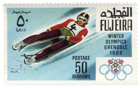 Fujeira - CIRCA 1968  A stamp printed in Fujeira shows descent to sledge, devoted to the Winter Games in Grenoble, series, circa 1968