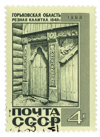 USSR - CIRCA 1968  A post stamp printed in the USSR and shows old carved wooden gate  1848   in Nizhny Novgorod region of Russia, series, circa 1968