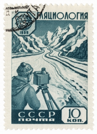 USSR - CIRCA 1959  A stamp printed in the USSR, shows researcher glaciologist takes measurements on a mountain glacier, circa 1959 Stock Photo - 17261533