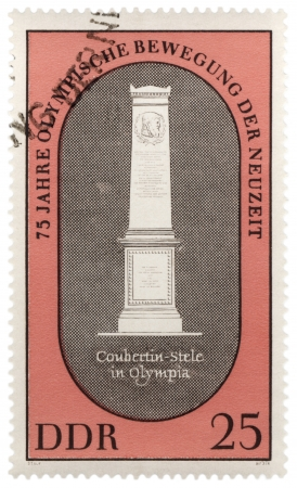 coubertin: GDR - CIRCA 1970  A stamp printed in GDR  East Germany  shows Stella at the grave of Pierre de Coubertin  founder of modern Games  in Olympia, series, circa 1970 Editorial