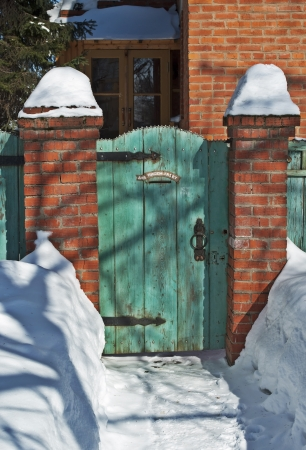 wicket gate: Old greeen vintage wooden gate, winter sunny day