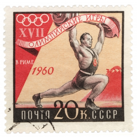 USSR - CIRCA 1960  A post stamp printed in USSR  Russia  shows weightlifter, dedicated to the Olympic Games in Rome, series, circa 1960 Stock Photo - 20132960
