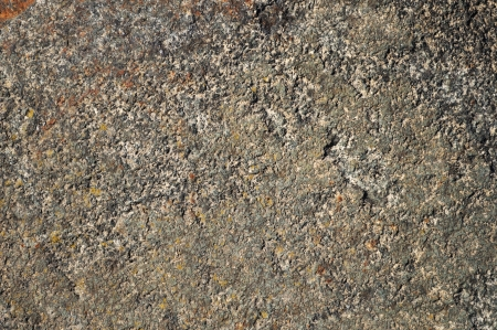 Fragment of rustic dark flat stone surface texture photo