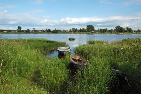 View of Onega riverbank with old boats in Kargopol, north Russia