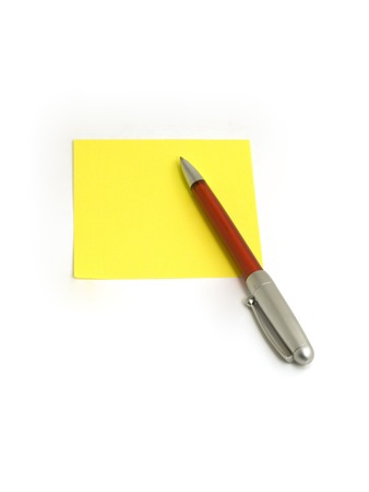 Red pen on a blank yellow paper on white background photo