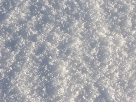 homogeneity: Texture of crystal snow surface on sunlight Stock Photo