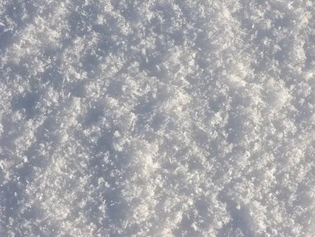 Texture of crystal snow surface on sunlight Stock Photo