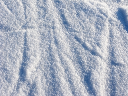 Texture of fresh snow surface on sunny day