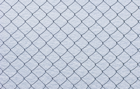 Close up of wire netting on snow surface background