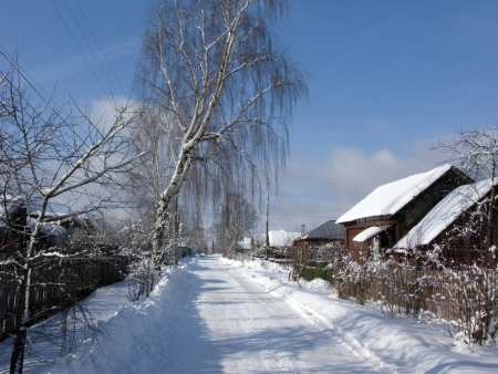 apparent: Snow covered winter road in russian village Stock Photo