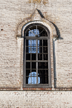 Big window of old destroyed orthodox church in village Igoshevo, Vologda region, Russia