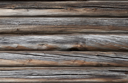 Close up of old cracked country wooden house wall, useful as background