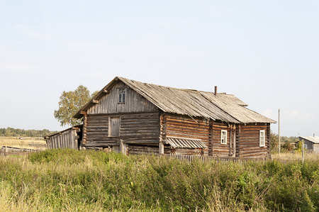 Old wooden house in northern russian village Stock Photo