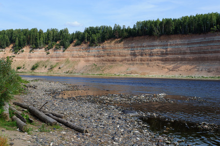 pebblestone: Geological outcrop on the Sukhona River near the former village Opoki, Northern Russia