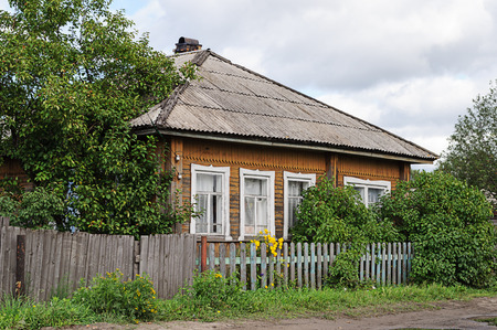 slate roof: Old small wooden house with slate roof in northern russian village Editorial