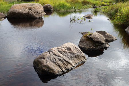 small river: Large rocks in a small river Tihmanga in Northern Russia, autumn time