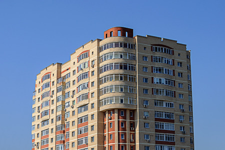 dwelling house: Top section of residential multi-storey dwelling house on blue sky background Editorial