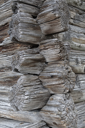 vernacular: Joint of logs on corner of ancient wooden house Stock Photo