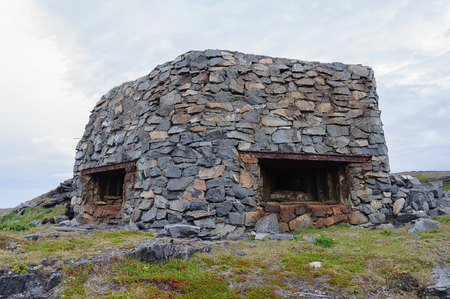embrasure: Remains of a German bunker from the Second World War on the Rybachy peninsula near Murmansk Stock Photo