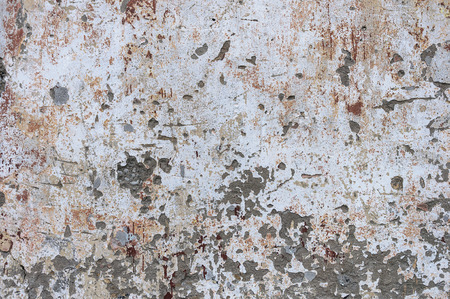 Texture of old jagged dirty white plastered wall