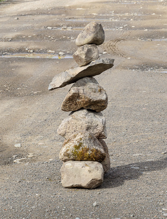 cairn: Cairn in the middle of the road. Concept of balance and harmony.