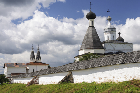 the medieval: Domes of the Ferapontov Monastery on cloudy sky background, sunny summer day, Vologda region, Russia