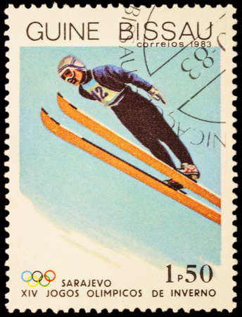 olympics: GUINEA-BISSAU - CIRCA 1983: stamp printed in Guinea-Bissau shows ski jumping, devoted to the 14th Winter Olympics in Sarajevo, series, circa 1983 Editorial
