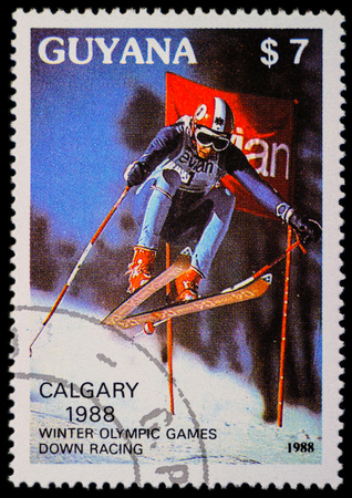 olympics: GUYANA - CIRCA 1988: a stamp printed in Guyana shows a downhill skier, devoted to Winter Olympics in Calgary in 1988, circa 1988 Editorial