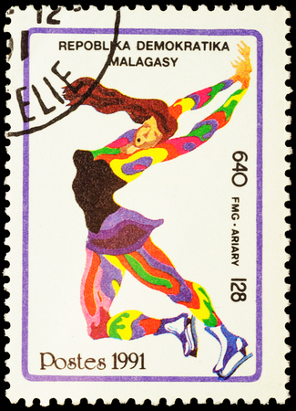 figure skater: MALAGASY - CIRCA 1991: stamp printed in Malagasy shows figure skater, devoted to the Winter Olympic Games in Albertville, series, circa 1991