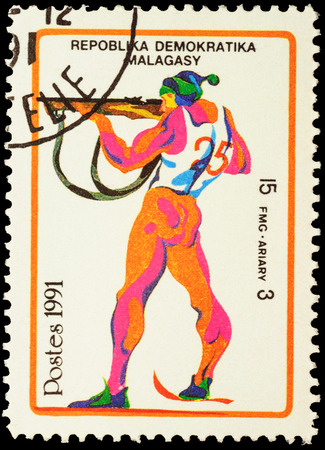 the olympic games: MALAGASY - CIRCA 1991: stamp printed in Malagasy shows shooting skier, devoted to the Winter Olympic Games in Albertville, series, circa 1991 Editorial