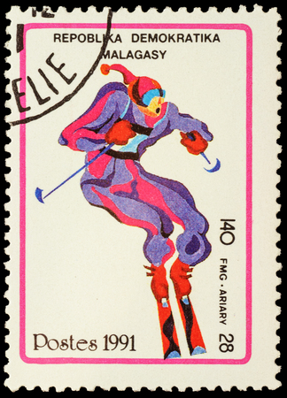 the olympic games: MALAGASY - CIRCA 1991: stamp printed in Malagasy shows ski slalom, devoted to the Winter Olympic Games in Albertville, series, circa 1991 Editorial