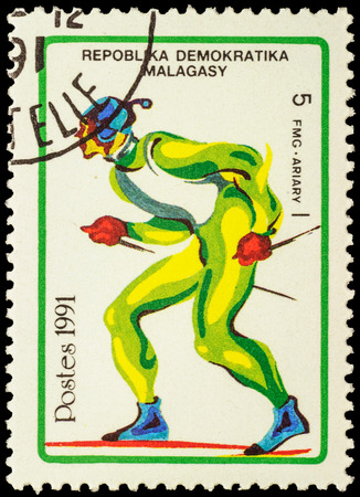 the olympic games: MALAGASY - CIRCA 1991: stamp printed in Malagasy shows running skier, devoted to the Winter Olympic Games in Albertville, series, circa 1991 Editorial