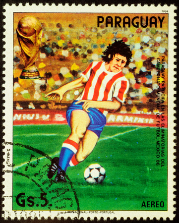 football world cup: PARAGUAY - CIRCA 1984: stamp printed in Paraguay shows running football player, devoted to the Football World Cup in Mexico 1986, series, circa 1984 Editorial