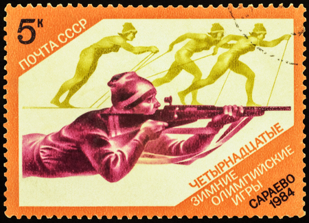 the olympic games: USSR - CIRCA 1984: stamp printed in USSR shows shooting man and running skiers, devoted to the Winter Olympic Games in Sarajevo, series, circa 1984
