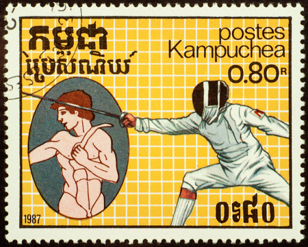 olympic games: CAMBODIA - CIRCA 1987: stamp printed in Cambodia shows ancient and modern swordsman, devoted to the Olympic Games in Seoul 1988, series, circa 1987 Editorial