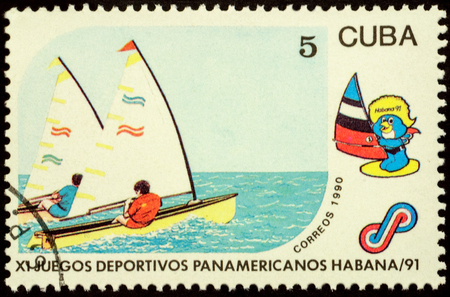 yachtsman: MOSCOW, RUSSIA - JANUARY 22, 2016: stamp printed in Cuba shows yachting, series The 11th Pan-American Games - Havana, 1991, circa 1990