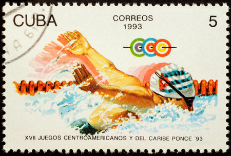 cuba butterfly: MOSCOW, RUSSIA - JANUARY 22, 2016: stamp printed in Cuba shows swimming athlete, series The 17th Central American and Caribbean Games - Ponce, Puerto Rico, circa 1993
