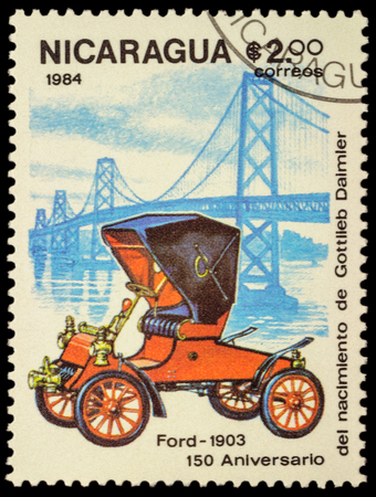 daimler: MOSCOW, RUSSIA - FEBRUARY 06, 2016: A stamp printed in Nicaragua shows old car Ford (1903), series The 150th Anniversary of the Birth of Gottlieb Daimler, 1834-1900 -  Vintage Cars, circa 1984