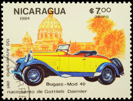 daimler: MOSCOW, RUSSIA - FEBRUARY 06, 2016: A stamp printed in Nicaragua shows old car Bugatti Type 40 (1926), series The 150th Anniversary of the Birth of Gottlieb Daimler, 1834-1900 - Vintage Cars, circa 1984